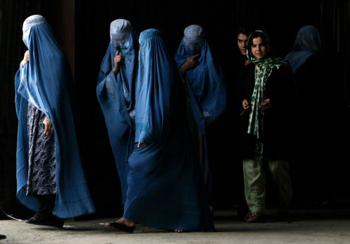 Afghan women leave after voting at a polling station during parliamentary elections in Kabul